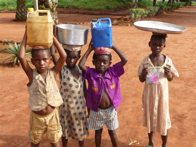 Kids carrying water
